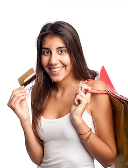 Young woman holding credit card and bags