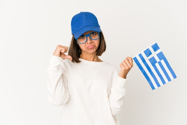 Young woman holding a greece flag