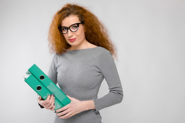 Young woman holding green folder