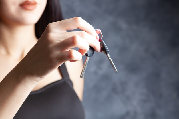 Young woman holding keys in her hands