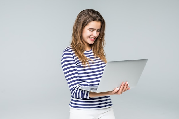 Young woman holding laptop on white background