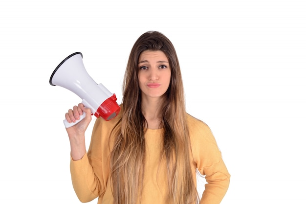 Young woman holding a megaphone.