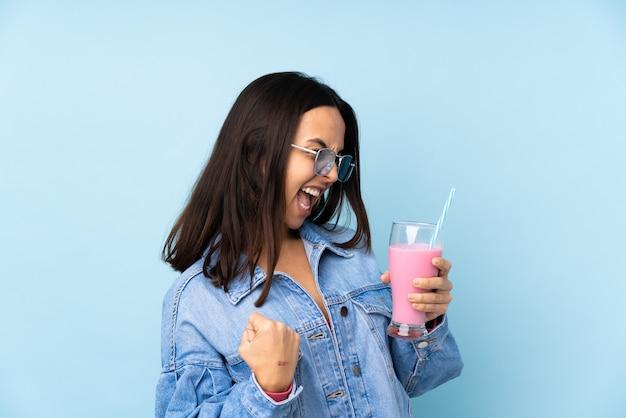Young woman holding a milkshake