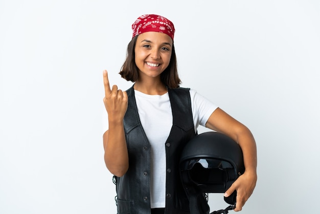Young woman holding a motorcycle helmet isolated on white doing coming gesture