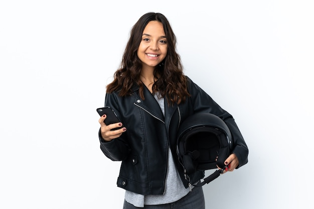 Young woman holding a motorcycle helmet isolated