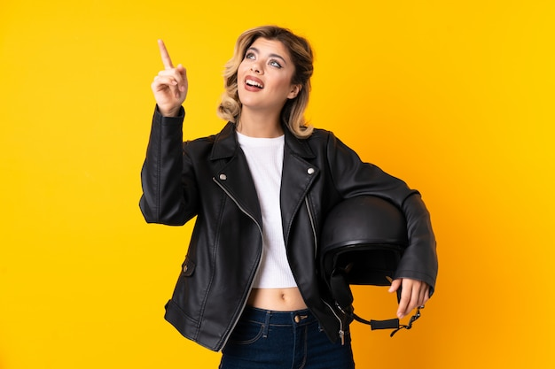 Young woman holding a motorcycle helmet