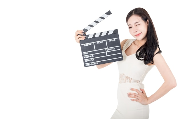 Young woman holding movie clapperboard isolated on white