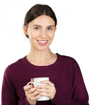 Young woman holding a mug with a hot drink isolated on white