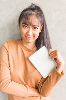 Young woman holding notebook