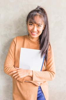 Young woman holding papers