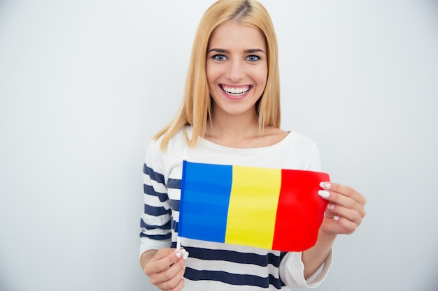 Young woman holding romanian flag