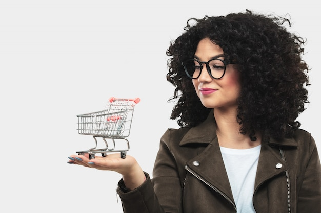 Young woman holding a shopping cart model