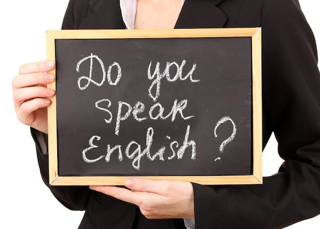 텍스트와 기호를 들고 젊은 여자 : 영어를 사용하세요?