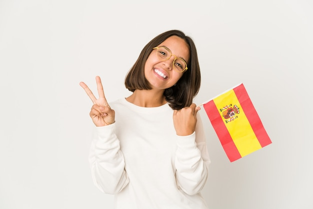 Young woman holding a spanish flag