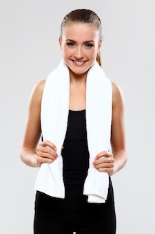 Young woman holding towel