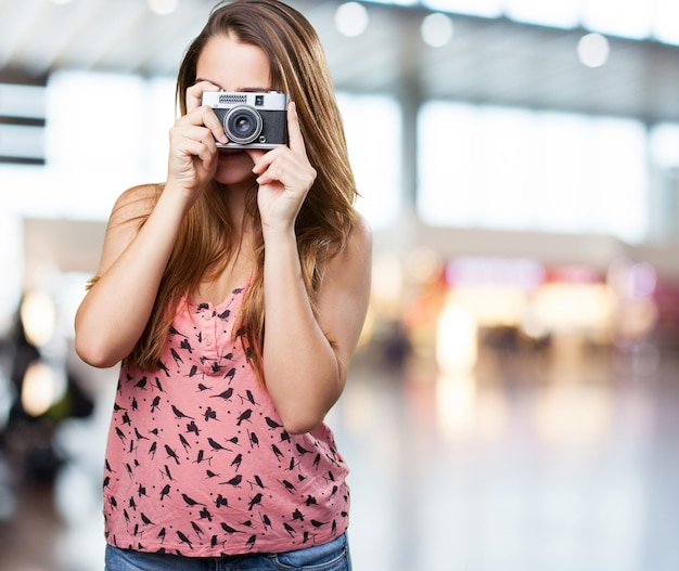 Young woman holding a vintage camera