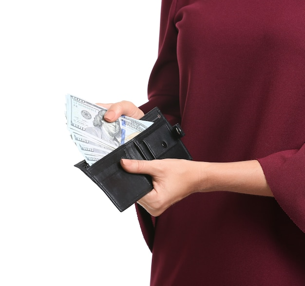 Young woman holding wallet with money isolated, closeup