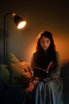 Young woman at home with mysterious interior lights around her
