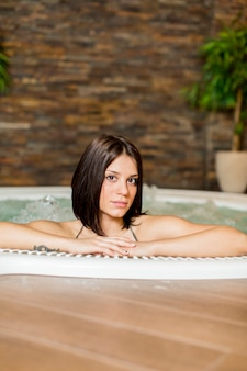 Young woman in the hot tub