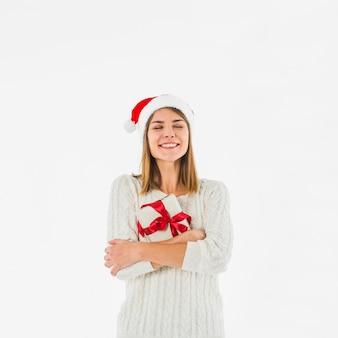 Young woman hugging gift box
