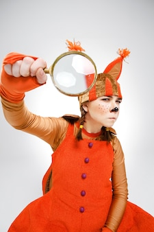 Young woman in image of squirrel with magnifying glass