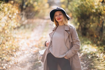 Young woman in hat in an autumn park