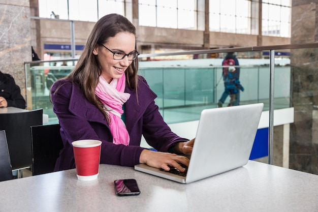 Young woman inside train station or airport