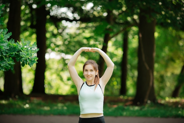 A young woman is engaged in sports, a healthy lifestyle,