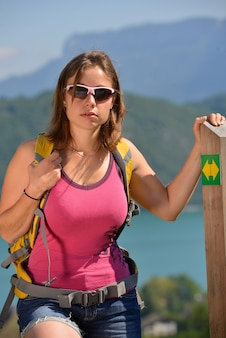 Young woman is hiking in the french alps