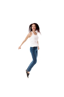 Young woman is jumping on white