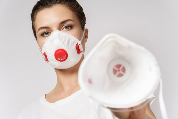Young woman is put on a face mask on someone for protection against virus