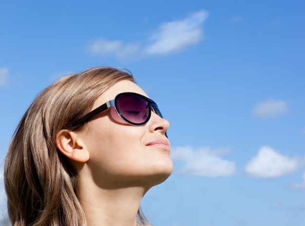 Young woman is wearing glasses outdoor