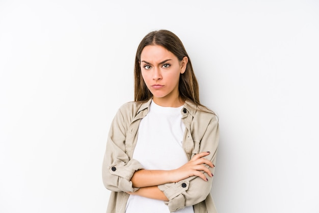 Young woman isolated unhappy looking in front with sarcastic expression