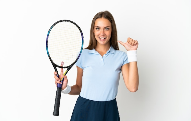 Young woman over isolated white background playing tennis and proud of himself