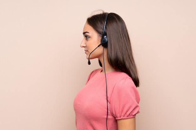 Young woman over isolated  working with headset