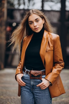 Young woman in jacket outside the street