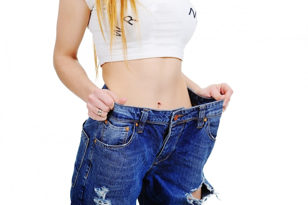 Young woman in jeans with large size