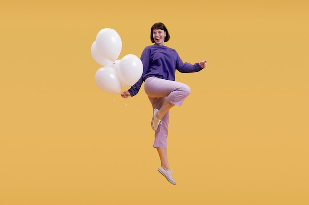 オレンジ色に孤立してジャンプ若い女性