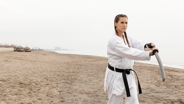 Young woman in karate costume outdoor