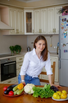 Young woman in the kitchen cooking