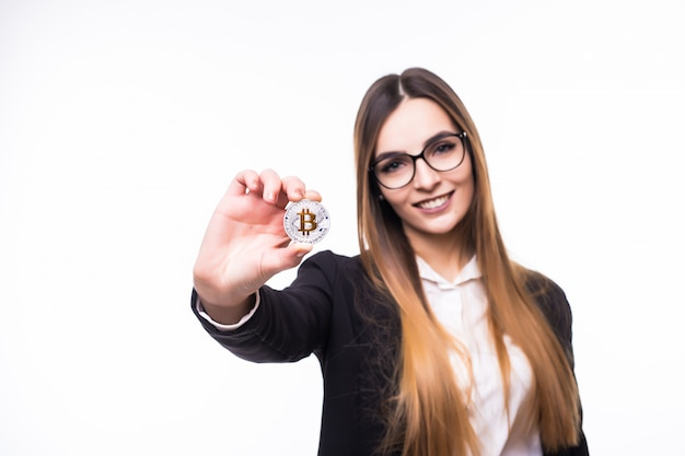 Young woman lady is holding bitcoin coin in her hands on white