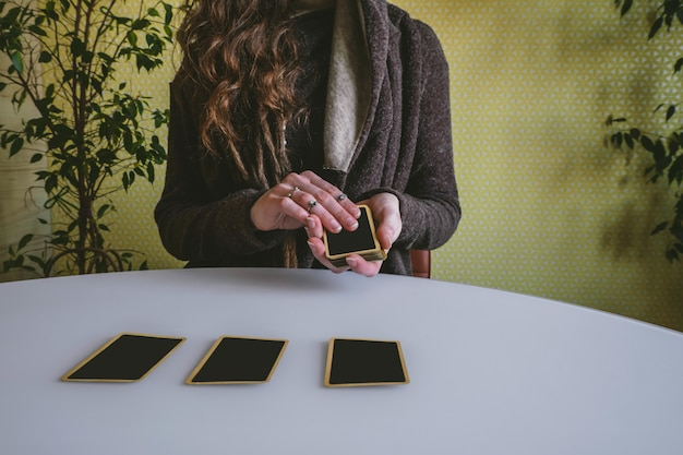 Young woman lays out cards on the table