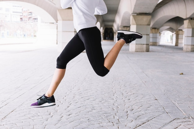 Young woman leaping