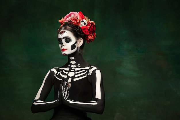 Young woman like santa muerte saint death