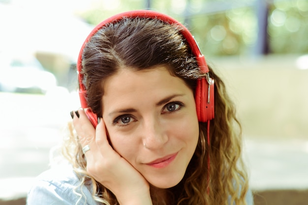 Young woman listening to music with headphones.