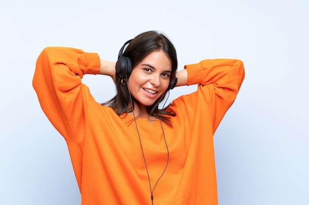 Young woman listening music with a mobile