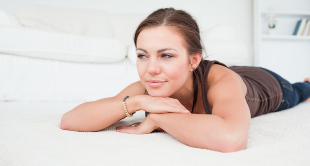 Young woman liying on a carpet