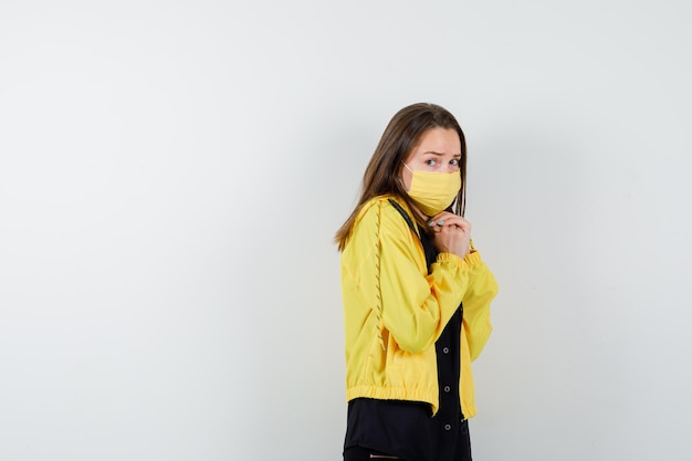 Young woman looking afraid