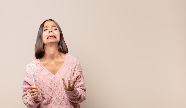 Young woman looking desperate and frustrated