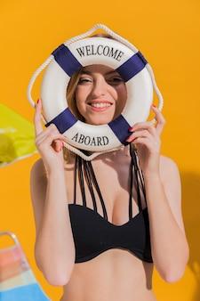 Young woman looking through lifesaver